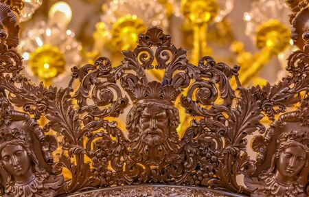 Saint Petersburg, Russia - October 4, 2015: Detail of an ornate chandelier on the ceiling of the State Hermitage  museum of art and culture in Saint Petersburg, Russia in the Winter Palace