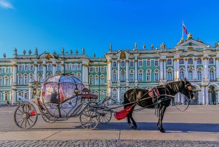 Saint Petersburg, Russia - October 04, 2015: Ornate horse carriage for hire awaiting tourist in front of the Winter Palace - Hermitage on Palace Square