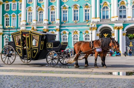 Saint Petersburg, Russia - September 10, 2017: Ornate horse carriage for hire awaiting tourist in front of the Winter Palace - Hermitage on Palace Square