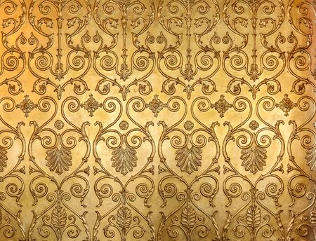 Saint Petersburg, Russia - October 4, 2015: Ornate floral golden pattern on a wall in the Hermitage museum in the Winter Palace Editorial