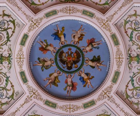 Saint Petersburg, Russia - October 4, 2015: Ornate ceiling of the State Hermitage museum in the Winter Palace with an allegorical representation of large Russian cities and the Russian coat of arms