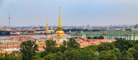 City skyline panorama with Admiralty spire, Peter and Paul Fortress, river Neva and Hermitage Winter Palace viewed from the roof of Saint Isaacs Russian Orthodox Cathedral in Saint Petersburg, Russia Фото со стока