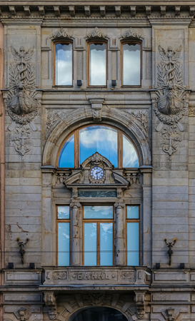 Beautiful facade of an old bank decorated with statues on Nevsky Prospect in Saint Petersburg Russia
