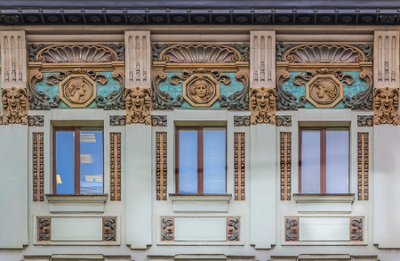 Beautiful facades decorated with relief on Nevsky Prospect in Saint Petersburg Russia Фото со стока