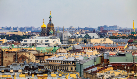 City skyline with the ornate domes of the Church of Savior on Spilled Blood viewed from the roof of Saint Isaacs Russian Orthodox Cathedral in Saint Petersburg, Russia Фото со стока