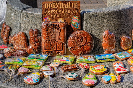 Ornate hand-made pryaniki, Russian honey spice cookies, shaped like toys and Russian ruble coins for sale out in the street in Saint Petersburg Russia Фото со стока