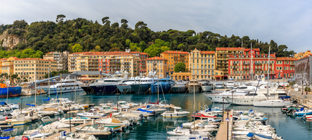 Panoramic view of boats in the marina and waterfront buildings in Nice port on the Mediterranean Sea, Cote dAzur, France
