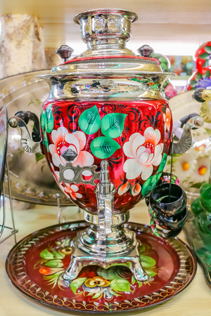 Colorful traditional Russian samovar teapot in a souvenir shop in Saint Petersburg, Russia Фото со стока