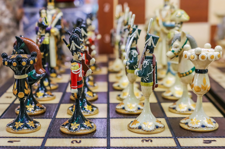 Colorful retro traditional Russian hand carved and painted wooden chess set in a souvenir shop in Saint Petersburg Russia Stock fotó