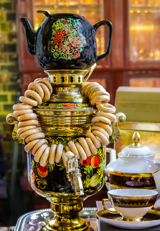 Russian samovar with a teapot on the top with bagels on it on display in Saint Petersburg, Russia