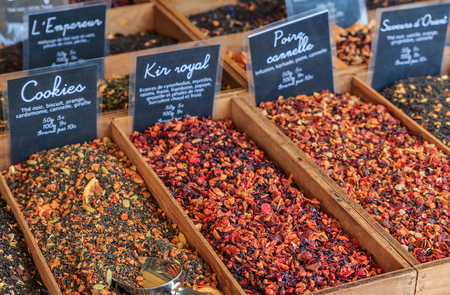 Exotic flavored teas with pear, cinnamon, kir royal, cookie and other flavors for sale at a local outdoor farmers market in Nice, France