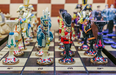 Colorful retro traditional Russian hand carved and painted wooden chess set in a souvenir shop in Saint Petersburg Russia