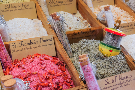 Exotic flavored salts with thyme, orange, strawberry chili and other herbs and spices for sale at a local outdoor farmers market in Nice, France Фото со стока