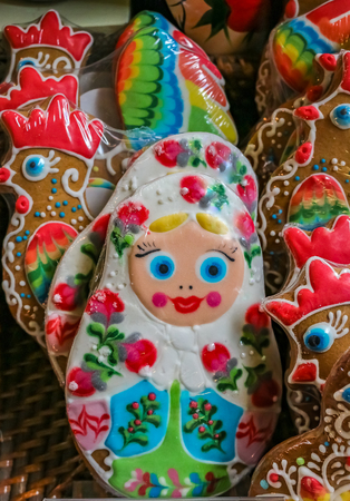 Ornate pryaniki, Russian honey spice cookies, shaped like matryoshka dolls on display at a grocery store  in Saint Petersburg, Russia