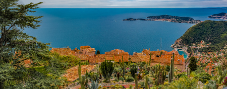 Scenic panoramic view of the Mediterranean coastline and medieval houses from the top of the town of Eze village on the French Riviera