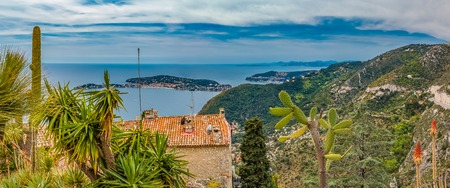 Scenic view of the Mediterranean coastline and medieval houses from the top of the town of Eze village on the French Riviera