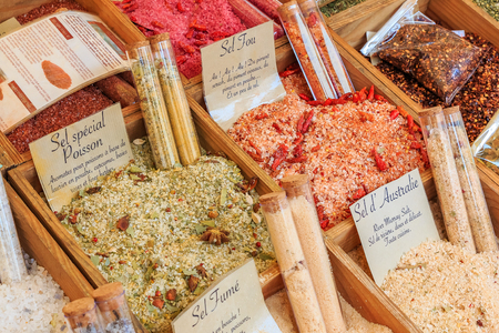 Exotic flavored,smoked and spicy salts with herbs and spices for sale at a local outdoor farmers market in Nice, France Фото со стока