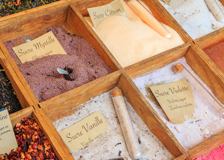 Exotic flavored sugars with lemon, blueberry, vanilla and other flavors for sale at a local outdoor farmers market in Nice, France Фото со стока