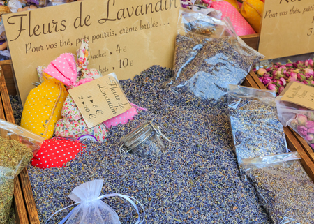 Exotic dried provencal lavender flowers for sale with a handwritten signs at a local outdoor farmers market in Nice, France Фото со стока