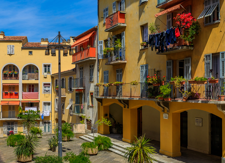 View of old traditional houses and a courtyard in the streets in the Old Town Vielle Ville in Nice in the South of France