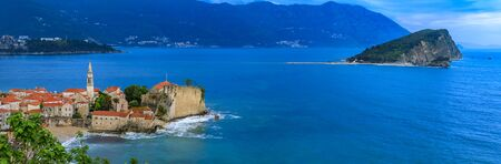 Panoramic view of Budva Old Town with the Citadel and the Adriatic Sea in Montenegro on the Balkans at sunset 版權商用圖片