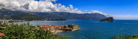 Aerial panorama of Budva Old Town with the Citadel and Island of St Nicholas or Hawaii in the Adriatic Sea in Montenegro on the Balkans on a sunny day 写真素材