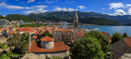 Aerial view of Budva medieval Old Town from the Citadel with the Holy Trinity church and Adriatic Sea with Richard s Head beach in Montenegro, Balkans 写真素材