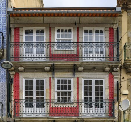 Facades of traditional houses decorated with ornate Portuguese azulejo tiles in the streets of Porto, Portugal 写真素材