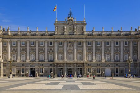 Madrid, Spain - June 4th, 2017: View of the ornate baroque architecture of the facade of the Royal Palace or Palacio Real and Plaza de la Armeria Editorial