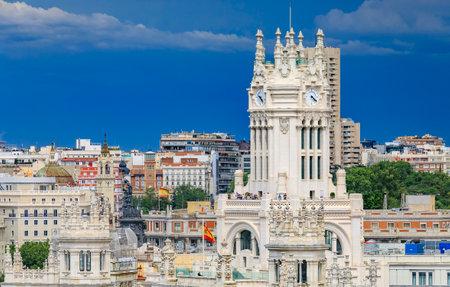 Madrid, Spain - June 4, 2017: Ornate gothic building of Cibeles Palace or Palacio de Comunicaciones on Plaza de Cibeles in Madrid, Spain, aerial view