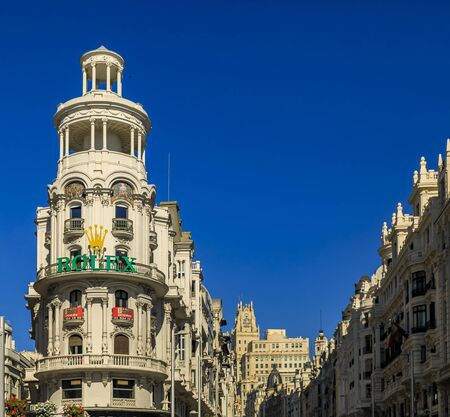 Madrid, Spain - June 4, 2017: Famous Edificio Grassy building with the Rolex sign, and beautiful buildings on Gran Via, main shopping street