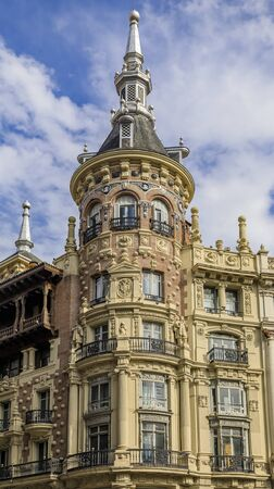 Madrid, Spain - June 5, 2017: Beautiful traditional residential buildings with metal balconies in the streets of the city center