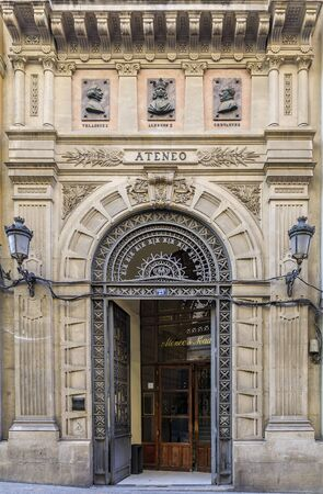 Madrid, Spain - June 4th, 2017: Details of an ornate metal front door in the center of the city