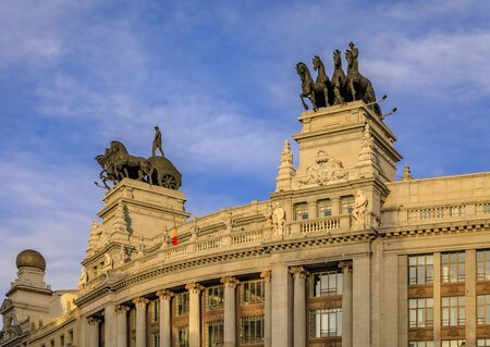 Madrid, Spain - June 4, 2017: Neoclassical quadriga or Roman Chariot statues on the Banco Bilbao Vizcaya BBVA bank building built in 1923