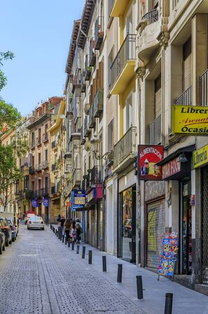 Madrid, Spain - June 5, 2017: Beautiful traditional residential buildings with metal balconies in the cobblestone streets of the city center Editorial