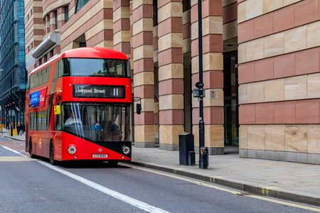London, England - January 14, 2018: Famous red double decker Routemaster bus on an empty street in central London