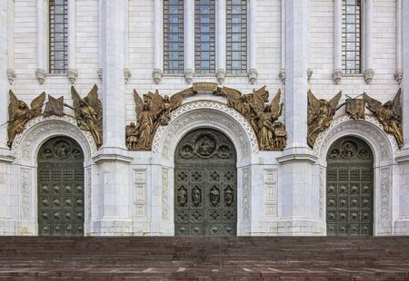 Close up of architectural details of the facade of the famous orthodox Cathedral Of Christ the Savior on a cloudy day in Moscow, Russia