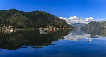 Panoramic view of Kotor Bay or Boka Kotorska with mountains reflecting in crystal clear water in the Balkans, Montenegro on the Adriatic Sea Standard-Bild