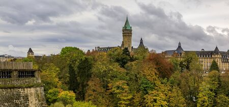 View of BCEE or Luxemburgish Spuerkeess Clock Tower of Luxembourg old town with its Old Quarters and Fortifications Stock Photo
