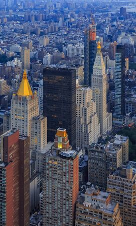 Sunset aerial view of iconic skyscrapers of New York Midtown Manhattan, country's largest commercial, entertainment, media and financial center Stock fotó