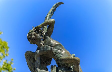 Close up of the Fountain of the Fallen Angel or Fuente del Angel Caido in the Buen Retiro Park in Madrid, Spain inaugurated in 1885 Foto de archivo