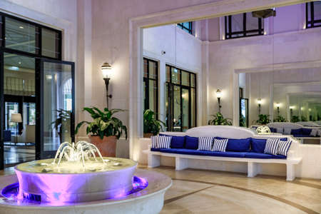 Tivat, Montenegro - May 31, 2019: Indoor fountain in the interior courtyard of Regent Porto Montenegro luxury hotel on the coast of the Adriatic Sea 新聞圖片