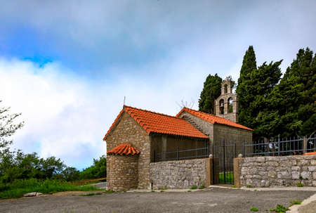 Traditional stone Crkva Svetog Krsta or Church of Holy Christ up in the mountains by Novoselje, Montenegro, above the Adriatic coastline