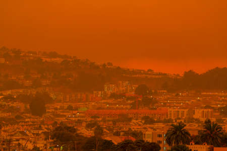 Thick orange haze above San Francisco on September 9 2020 from record wildfires in Californa, daytime view of ash and smoke floating over the Bay Area