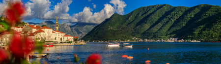 Scenic panorama of the postcard perfect historic town of Perast, old Venetian city in the Bay of Kotor on a sunny day in the summer in Montenegro