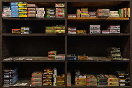 Placerville, USA - November 25, 2020: Half empty shelves with rifle ammo boxes at a gun shop, ammunition shortage in California