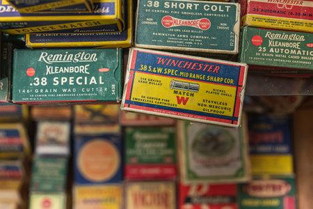 Placerville, USA - November 25, 2020: Vintage pistol bullet cartridge ammo boxes by Remington and Winchester at a gun shop, 38 caliber and 38 short Redakční