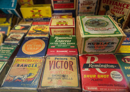 Placerville, USA - November 25, 2020: Vintage shotgun shells cartridge boxes by Remington, Winchester and other ammunition manufacturers at a gun shop