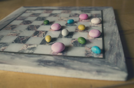 checkers: candy on the board instead of checkers