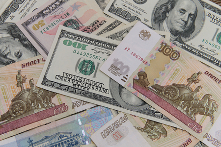 Background of the us dollars and russian rubles banknotes